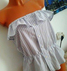 Стильная блузка с воланом без рукавов