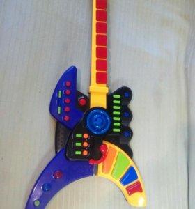 Гитара музыкальная.