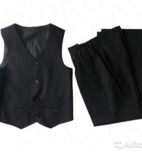 Костюм школьный новый черный (жилет+ брюки) 7-14 л