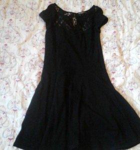 Расклешенное платье,с ажурным вырезом