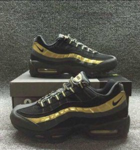 Gold and Black Nike 95