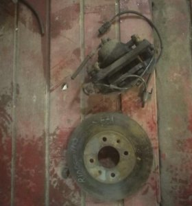 Суппорт и тормозной диск Kia Rio 2