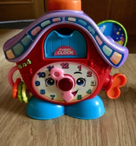 Музыкальная игрушка Часы