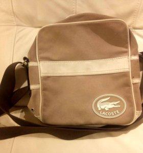 Бежевая сумка Lacoste