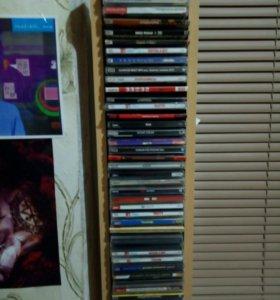 Коллекция дисков с музыкой (рок группы) с подставк