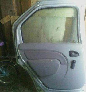 Дверь левая задняя Рено Логан