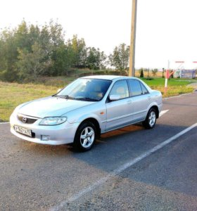 Mazda 323 2003 год