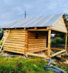 Сруб бани с верандой под общей двускатной крышей