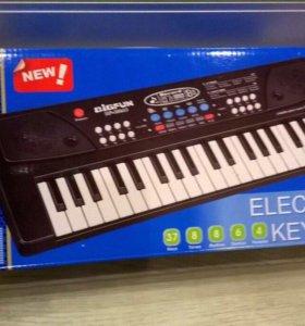 Новый синтезатор игрушечный