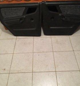 Обшивки задних дверей газ 31105
