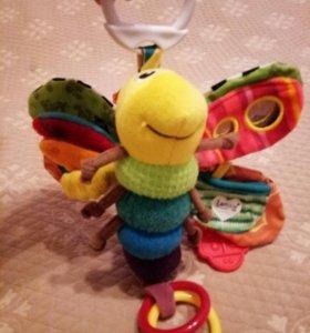 Детская игрушка погремушка