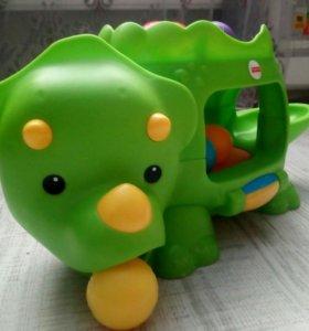 Развивающая игрушка динозавр с шариками