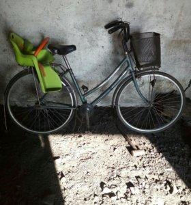 Велосипед с детской сидушкой