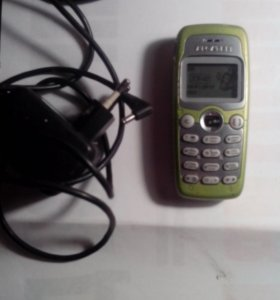 Рабочий сотовый телефон ALCATEL с зарядкой