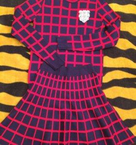 Костюм(юбка+кофта)Состояние нового