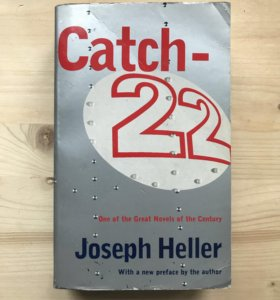 the conflict between humanity and the rules in joseph hellers catch 22 The novel catch 22 was published in 1961 by joseph heller it recounted the story of a group of soldiers fighting in world war ii this event happened in world war ii although yossarian and the other squadron members were not actually the bombers.