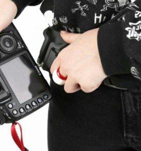 Поясное крепление для фотоаппаратов