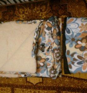 Меховой конверт в коляску