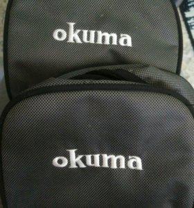 Сумки Okuma для рыболовных катушек.