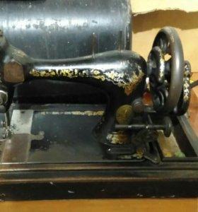 Швейная машина зингер.