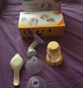Молокоотсос medela (ручной)+ пакеты для молока