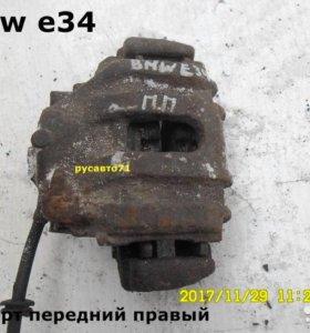 Суппорт передний левый и правый бмв е34