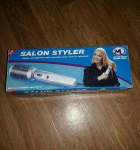 Электрическая щетка для укладки волос.