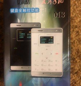 Телефон(новый)размером с кредитную карту