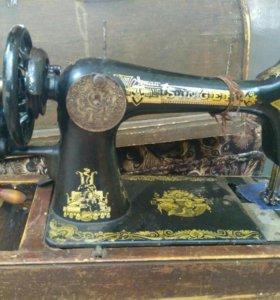 Швейная машина фирмы Зингер