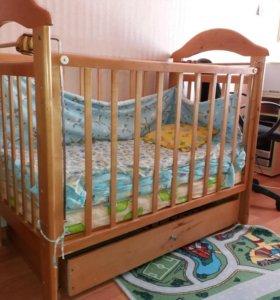 Маитниковая кроватка