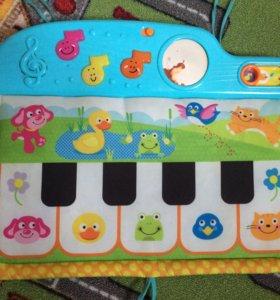 Музыкальное пианино на кроватку