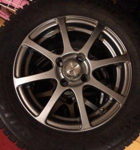 Комплект колес с зимней шипованной резиной