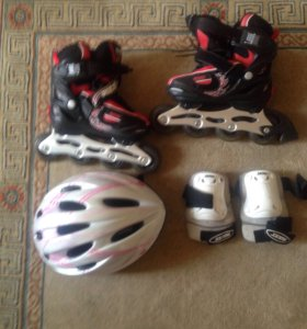 Роликовые коньки +шлем +налокотники