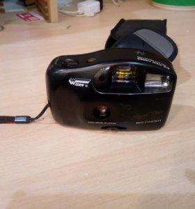 Фотоаппарат пленочный, в рабочем состоянии