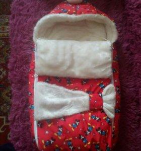 Зимний конверт для новорожденного ребенка.