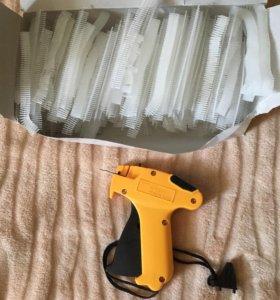 Игольчатый пистолет и держатели ценников