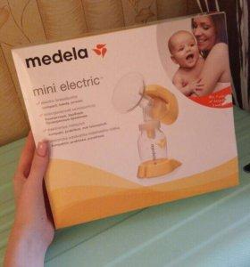 Молокоотсос электрический новый Medela