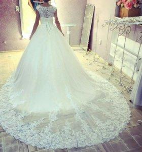 Продам свадебное платье+в подарок кольца и чехол