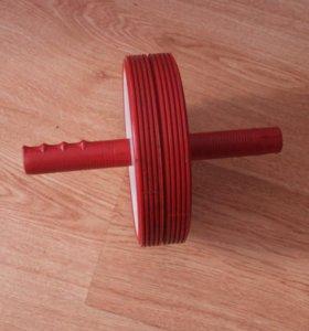 Гимнастическое колесо или тренажёр для пресса