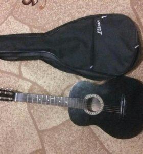Окустическая гитара.