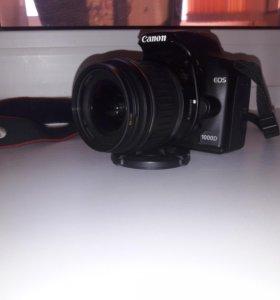 Продам зеркальный фотоаппарат Canon 1000 d
