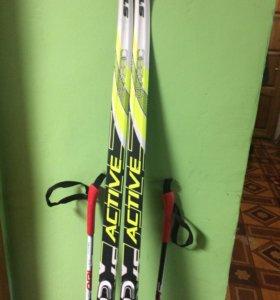 Лыжные ботинки и лыжи