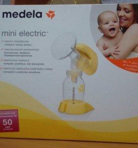 Молокоотсос Medela mini electric