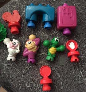 Игрушки от конструктора pop-onz от fisher price