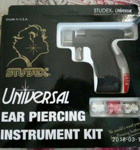 Пистолет для прокола ушей.