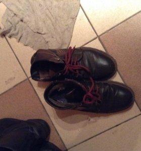 ботинки бывшие в употреблении