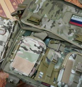 Утеряна камуфлированная сумка на остановке напроти
