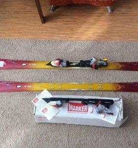 Новые горные лыжи с креплениями