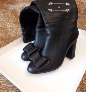 Итальянские кожаные сапоги б/у в хорошем состоянии