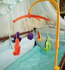 Детские игрушки на кроватку